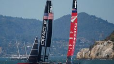 Emirates Team New Zealand overturned in high winds on Tuesday, catapulting a portion of the group into the water and giving adversaries Britain's Land Rover