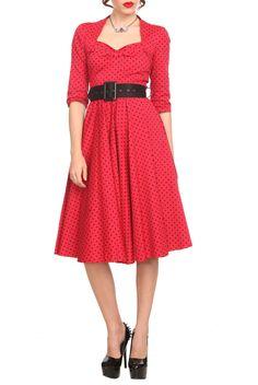 Red swing dress with black polka dots and black belt. Back zipper closure.
