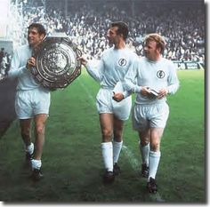 Norman Hunter, Paul Reaney and Billy Bremner show off the Charity Shield after beating Manchester City