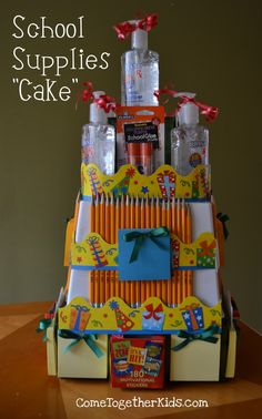 "School Supplies Cake ~ Take advantage of back-to-school sales and stock up on supplies to make a ""cake"".  Great idea for a teacher gift or to give to your own kids as a welcome back to school treat."