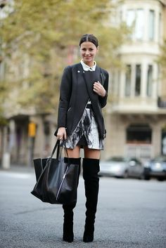 {Street style} | Black leather jacket, white button up blouse, printed wrap skirt, black over-the-knee boots, black tote bag.
