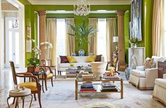 """Jane Scott went one step further and lacquered the walls chartreuse. It's a bold choice (""""That took a moment of bravery!"""" she laughs), but with the crisp white moldings and otherwise-neutral decor, the color doesn't overwhelm—it glows."""