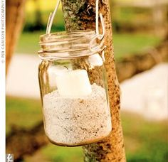 the-knot-mason-jars-filled-with-sand-and-candles-outdoor-light.jpg 310×300 pixels