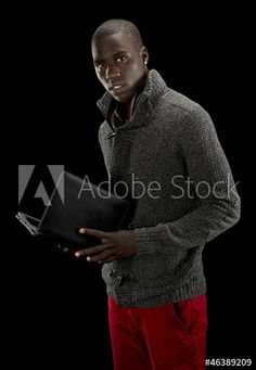 Pants too colorful // should be a book? //  African american man with a tablet pc