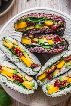 Onigirazu or Sushi Sandwiches are an easy & versatile alternative to your ordinary lunch and SO delicious! I've got you covered with delicious onigirazu filling ideas as well as a video tutorial. Sushi Sandwich, Sandwich Recipes, Sushi Burger, Vegan Vegetarian, Vegetarian Recipes, Healthy Recipes, Japan Sushi, Onigirazu, Deserts