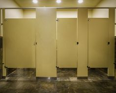 Ironwood Manufacturing laminate toilet partitions and bathroom doors. Clean lines for public restroom stalls.
