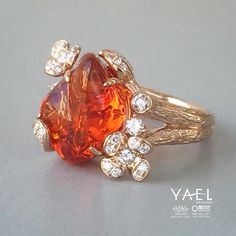 Can you think of an appropriate occasion to wear our latest fire opal and diamond ring? #fireopalring #yaeldesigns