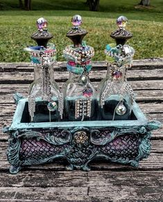 Altered bottles, rhinestone bottles, gypsy decor, boho decor, embellished bottles, vanity decor, treasure chest, bohemian bedroom   #gypsydecor  #alteredbottles  #rhinestonealteredbottles