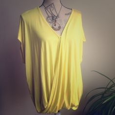 Faux Wrap Top Yellow short sleeves with 1 button in the front. Pair with Palazzos, Shorts etc... 95% Rayon 5% Spandex. Women size. Cute for Spring & Summer. Never worn. Philosopy Women Tops Blouses