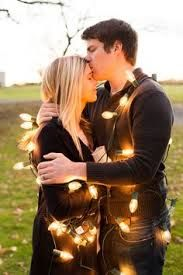 Couples chirstmas photo idea with lights outdoors