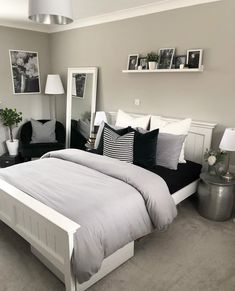 Luxury grey bedroom inspiration, grey and white modern bedroom with picture shelf styling and bedside tables, a reading corner and pillar candlesticks. White Bedroom Design, White Bedroom Decor, Home Decor Bedroom, Bedroom Chair, Bedroom Designs, Black White And Grey Bedroom, Bedroom Ideas Grey, Modern Grey Bedroom, Bed Room
