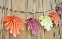 While you're busy prepping in the kitchen and setting the table, have the little ones create some home decor by this easy project that involves paper crafting a beautiful leaf garland to hang when guests arrive!