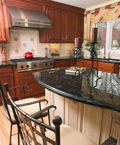 Semi Custom Cabinetry with Volga Blue Granite countertops and tumbled limestone backsplash by Virginia Tile. Charleston Forge Barstools, custom cornice with swags and tails in Pindler & Pindler fabric. Dazzling Designs, LLC Donna Brown - Northville, MI