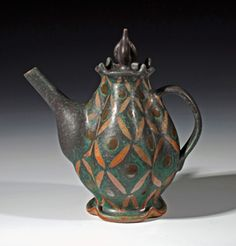 Great treatment. Lovely shape. Beautiful colors. Amazing teapot.