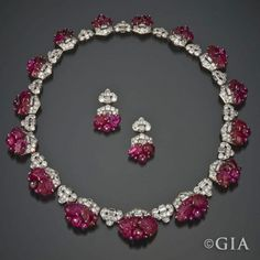 The Timeless Allure of Art Deco - GIA 4Cs - Mauboussin carved rubies and diamonds necklace and earrings. Circa 1930.