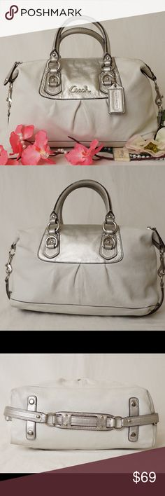 """💞💞COACH Ashley Leather Satchel Platinum COACH Sabrina Ashley Leather Satchel Shoulder Bag Handbag Purse White Silver 15445  Inside zip, cell phone and multifunction pockets Zip-top closure, fabric lining Handles with 5"""" drop Feet to protect bottom from scuffing 12 1/2"""" (L) x 8"""" (H) x 4 1/2"""" (W) Very pretty. Beautiful. Gently used, exterior corners have slight worns. Interior has slight dirt stains can be cleaned. Pet smoke free home.   AUTHENTIC❣️LEATHER ❣️FAST SHIPPING!❣️MAKE AN OFFER…"""