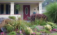 Informal, cottage-style landscaping sets the tone for this home. front-porch-ideas-and-more.com #flowerbed
