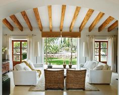Comfy Spaces.. Love the beams