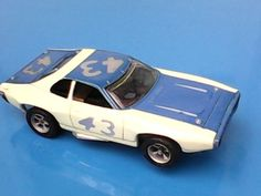 Vintage Aurora AFX HO Slot Car Plymouth Roadrunner 43 Richard Petty White Blue | eBay Afx Slot Cars, Richard Petty, Slot Car Tracks, Road Runner, Car Videos, Ho Scale, Courses, Plymouth, Hot Wheels