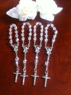 30 pcs  First communion favors / Mini  Rosary Baptism Favors / Baptism favors / Religious Mini Rosary / Narelo by NARELO on Etsy https://www.etsy.com/listing/193065206/30-pcs-first-communion-favors-mini