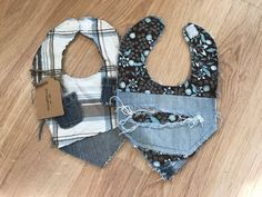 Stylish denim bibs that compliment any little persons attire! Made for infant/toddler ages 0-2. The plaid bib is a bit smaller however it did fit my 14 month old pretty well and he is big for his age. Durable yet stylish for those little ones who need to protect their clothes from drooling or during meal time. Plaid bib is constructed of plaid denim front with 2 mini denim pockets, back is made of solid blue denim.  Flower bib is constructed of stylish brown/teal 100% cotton flower fabric…