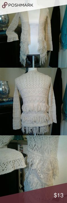 "Fringe cardigan Women's like new Arizona cream open knit cardigan with fringe. Size tag says small 7/8, which makes no sense. It fits a juniors small. Measurements Chest 16"" length 25"" sleeve 22"". Thanks for looking Bundle to save!! Arizona Jean Company Sweaters Cardigans"