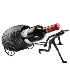 Man And Barrel Wine Bottle Holder 50706 Found At MyNobleBear.com Wine Bottle Holders, Candle Holders, Mosaic Animals, Old Technology, Bronze Finish, Sale Items, Home Kitchens, Cast Iron, Barrel
