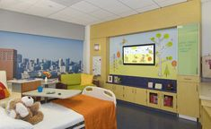 Acute Pediatric Room Mediawall. A mock-up of a room at the future UCSF Benioff Children's Hospital at Mission Bay with a multimedia wall.