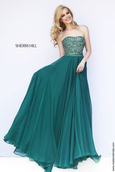 New for 2015...Ritzy beadwork gilds the lustrous bodice of Sherri Hill 11179 prom dress, accentuating the strapless straight across neckline as the beading culminates into a distinct band hugging the natural waist. From there, the rich layers of soft fabric billow onto the floor length where it finishes with a sumptuous swirl. Also available in Purple, Royal, Red and Turquoise.