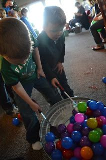 Relay Race - scoop up balls at one end of the room and carry them in their spoons to the bucket at the other end of the room.