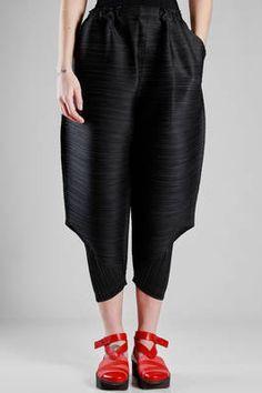 Pleats Please   wide trousers in polyester plissé with narrow vertical strip   #pleatsplease