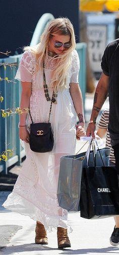 Ashlee Simpson wearing Chanel Vintage Sack Bag in Black Plain Leather.