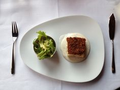 Fresh salt cod fillet in a tomato crust white almond sauce oregano and mixed salad Quadri Alajmo restaurant Venice