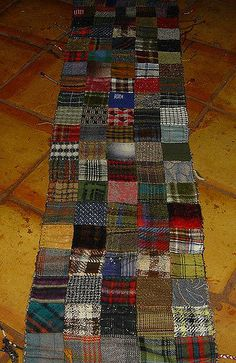 """jude hill, wool patchwork scarf - wool patchwork quilted to hand woven scarf for a double layer """"mad warm"""" wrap. 6 5 Prev Next wool patchwork quilted to hand woven scarf for a double layer """"mad warm"""" wrap. Recycled Sweaters, Recycled Clothing, Plaid Laine, Tartan Clothing, Wool Quilts, Small Sewing Projects, Nine Patch, Wool Art, Penny Rugs"""