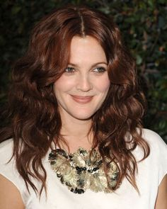 A dimensional, chocolatey reddish brown beautifully compliments pale skin tones, like this look on Drew Barrymore.