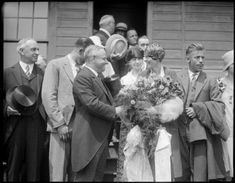 Mayor Malcolm Nichols presenting bouquet of roses to Amelia Earhart, 1928
