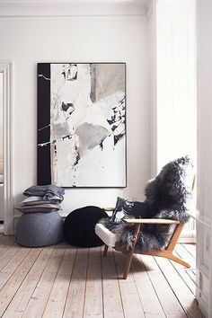 Armchair is by Hans Wegner, the cushions from By Nord. For a similar sheepskin, try Toast