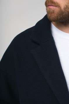 Soft luxurious man coat from virgin wool one button fastening elegant scandinavian style simple