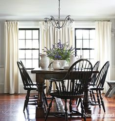 White creamware on table. black windsor chairs with dark wood table. Gorgeous windows too! Dining Room Design, Dining Room Table, Dining Chairs, Dining Rooms, Table Lamps, New England Homes, Dining Room Inspiration, House And Home Magazine, Black Kitchens