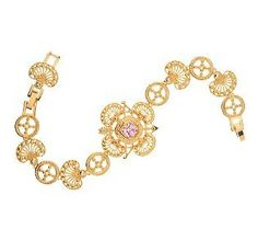 In 1962, she set off for India with her sister, Lee, on an unofficial state visit where she wore this bracelet and matching necklace with the seashell design. Although Nehru and John F. Kennedy didn't see eye to eye on some issues, Jackie, on the other hand, was able to charm international dignitaries; and the trip was a great success.