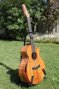 Custom 12-string,  not sure if it's a Kevin Ryan, he's the one who who is known for fluted sound holes in a beveled armrest.