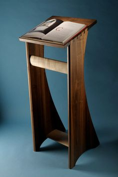 (Chapter 7) A lectern is a stand to support a book on. It could also be used as a table or desk for writing. A cabinet could be found below and in the seventeenth century it was the Bible box. Today lecterns are used in a classroom, conference area, and are still used in churches.