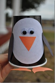 Paper Cup Penguin Craft. Could also put holes on the side to make cute penguin garland! :)