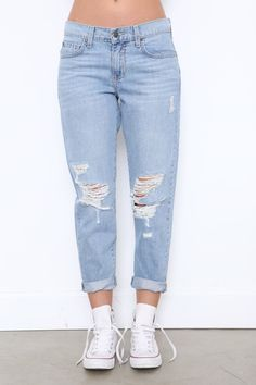 "Faded and distressed boyfriend jean. Five pocket construction. Front button and zipper fly closures. Style #: P8520 Material: Cotton Color: ""Rampid"" (Blue) Model is wearing a size 27"