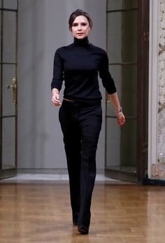 Victoria Beckham Slacks - Victoria Beckham paired her sweater with basic black trousers.