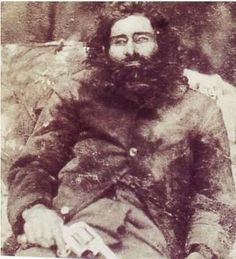 April 1865 The notorious bushranger Dan Morgan was shot on this day in at a homestead at Peechelba. He layed wounded for a number of hours with out medical attention, before dying at His body was taken to the woolshed, and placed on public display. Victorian Photos, Vintage Photos, Ned Kelly, Post Mortem Photography, Head In The Sand, Australian Bush, Public Display, Hair And Beard Styles, Memento Mori