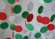 red, white and green dots.  garland machine sewn together and hung. simple and cheap, make a big impact.  Could also cricut pizza toppings and make similar garland.