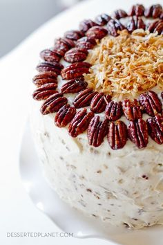 Fresh Orange Italian Cream Cake.  Super moist yellow cake w/ coconut and orange mixed into the batter, layered with orange marmalade and pecan cream cheese frosting.  DIVINE. | DessertedPlanet.com