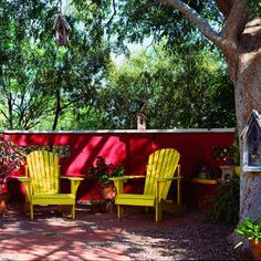40 ideas for patios   Red-hot patio   Sunset.com - love this bright wall and pop of the yellow chairs!