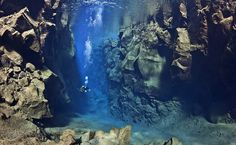 Diver Swimming Between Tectonic Plates